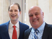 Oregon Senator Ron Wyden and Attorney Brian Mahany at the signing for the Whistleblower Day Resolution July 30, 2015 Photo Credit, ML McLaren