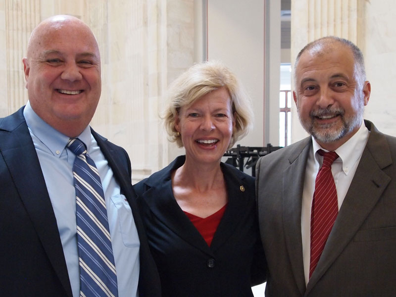 Attorney Brian Mahany, Wisconsin Senator Tammy Baldwin, and Whistleblower Martin Anderson at the signing of the Whistleblower Day Resolution Conference in Washington DC July 30, 2015